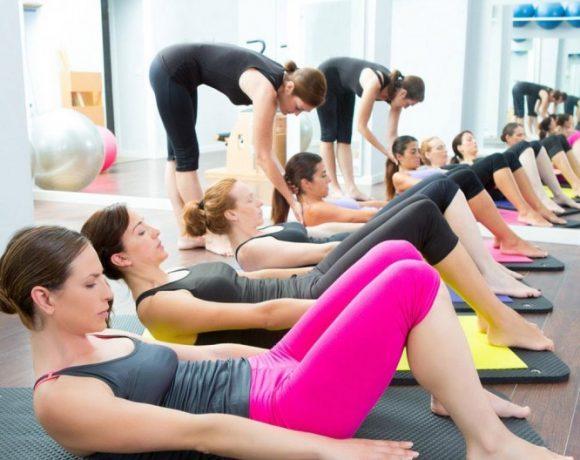 Young Women Doing Abdominal Training